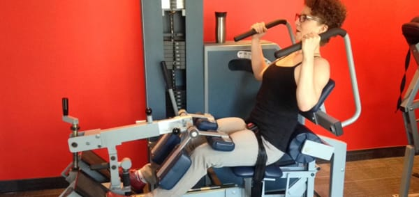 Woman working out on exercise equipment at OneUp in Halifax.