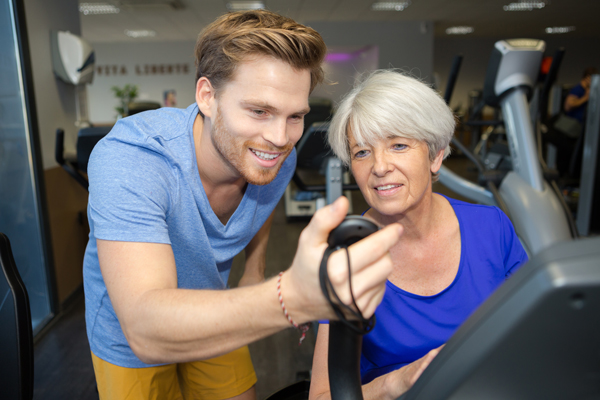 older woman with trainer