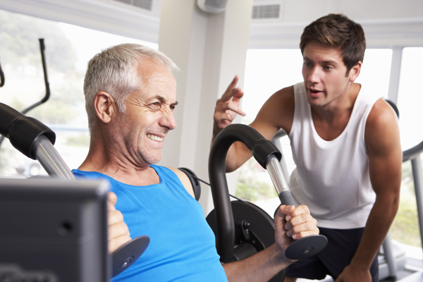older man working out in the gym